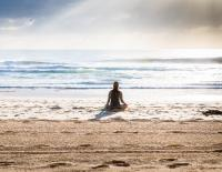 WORK Mindful Moments woman on beach meditating